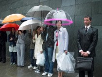 Waiting in line in rain